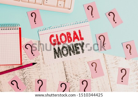 Text sign showing Global Money. Conceptual photo International finance World currency Transacted globally Writing tools, computer stuff and math book sheet on top of wooden table. #1510344425