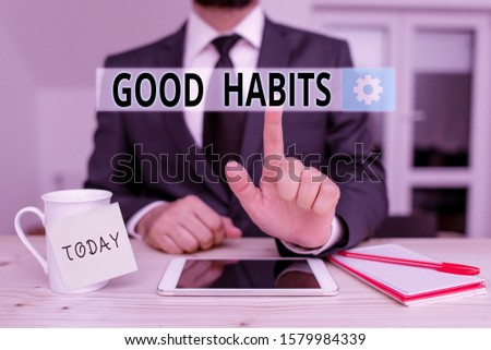 Text sign showing Good Habits. Conceptual photo behaviour that is beneficial to one s is physical or mental health Male human wear formal clothes present presentation use hi tech smartphone.
