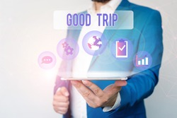 Text sign showing Good Trip. Conceptual photo A journey or voyage,run by boat,train,bus,or any kind of vehicle Male human wear formal work suit presenting presentation using smart device.