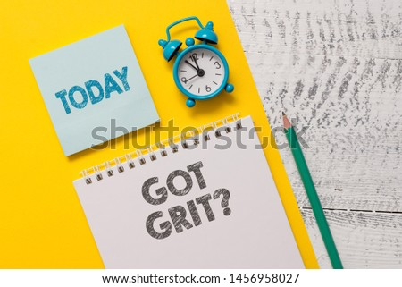 Text sign showing Got Grit Question. Conceptual photo A hardwork with perseverance towards the desired goal Spiral notepad paper sheet marker alarm clock retro wooden background.