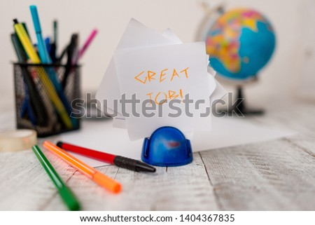 Text sign showing Great Job. Conceptual photo used praising someone for something they have done very well Stationary plus pens and papers with artificial globe on the wooden desk. #1404367835