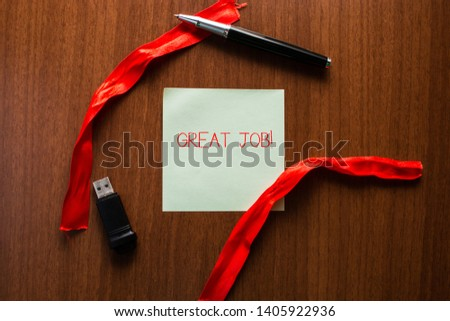 Text sign showing Great Job. Conceptual photo used praising someone for something they have done very well USB memory lying wooden table square blank note stripes ribbon up down pen. #1405922936