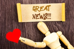 Text sign showing Great News. Conceptual photo Success Newspaper Information Celebration written Sticky Note Love Heart Holding By Sculpture the wooden background.