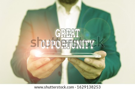 Text sign showing Great Opportunity. Conceptual photo an appropriate or favorable time or occasion to venture Businessman holds laptop in his hand. Man holding mobile phone with touch screen.