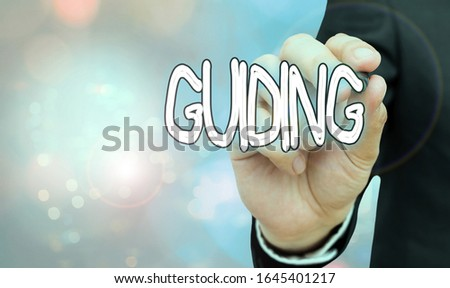 Text sign showing Guiding. Conceptual photo to show someone how to do something difficult Indicate the way.