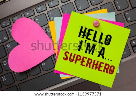 Text sign showing Hello I am A ... Superhero. Conceptual photo Special powers Cartoon character Customs strenght Bright colorful written papers pinch by pin pink heart on computer keyboard. #1139977571
