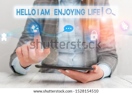 Text sign showing Hello I Am Enjoying Life. Conceptual photo Happy relaxed lifestyle Enjoy simple things Female human wear formal work suit presenting presentation use smart device. #1528154510