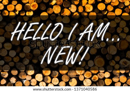 Text sign showing Hello I Am New. Conceptual photo used as greeting or to begin telephone conversation Wooden background vintage wood wild message ideas intentions thoughts.