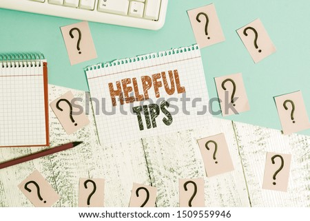 Text sign showing Helpful Tips. Conceptual photo Useful secret Information Advice given to accomplish something Writing tools, computer stuff and math book sheet on top of wooden table. Photo stock ©