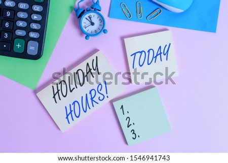 Text sign showing Holiday Hours. Conceptual photo employee receives twice their normal pay for all hours Wire mouse portable calculator notepads paper sheets clips color background.