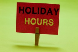 Text sign showing Holiday Hours. Conceptual photo Schedule 24 or 7 Half Day Today Last Minute Late Closing Clothespin holding red paper important communicating messages ideas.