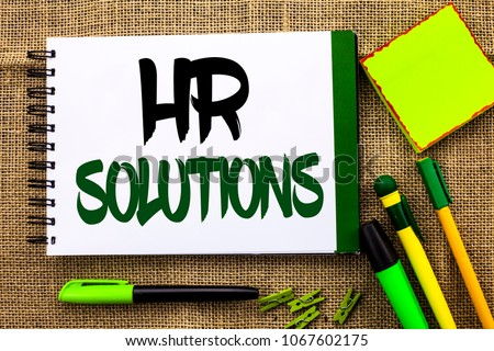 Text sign showing Hr Solutions. Conceptual photo Recruitment Solution Consulting Management Solving Onboarding written on Notebook Book on the jute background Pens Clips Sticky Note next to it.