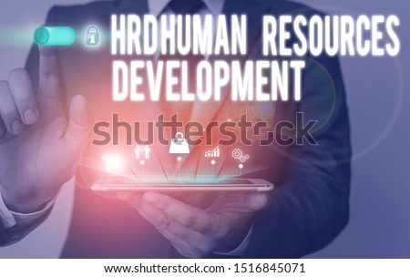 Text sign showing Hrd Huanalysis Resources Development. Conceptual photo helping employees develop demonstratingal skills Male human wear formal work suit presenting presentation using smart device.