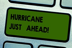 Text sign showing Hurricane Just Ahead. Conceptual photo violent tropical cyclone is approaching to hit the land Keyboard key Intention to create computer message pressing keypad idea.