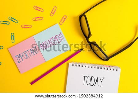 Text sign showing Important Announcement. Conceptual photo spoken statement that tells showing about something Square sticky notepads pencil clips eyeglasses yolk color background.