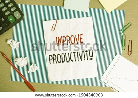 Text sign showing Improve Productivity. Conceptual photo to increase the machine and process efficiency Striped paperboard notebook cardboard office study supplies chart paper.