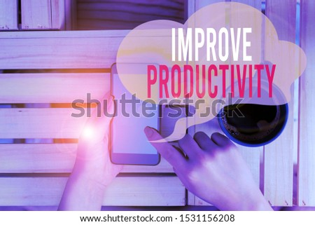 Text sign showing Improve Productivity. Conceptual photo to increase the machine and process efficiency woman computer smartphone drink mug office supplies technological devices.