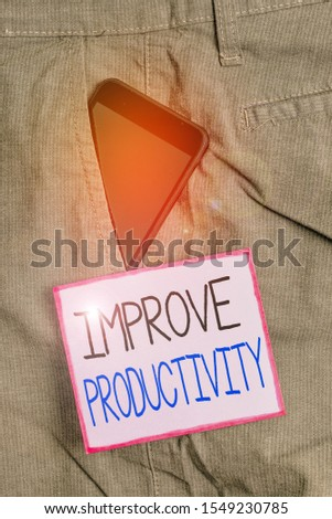 Text sign showing Improve Productivity. Conceptual photo to increase the machine and process efficiency Smartphone device inside formal work trousers front pocket near note paper.