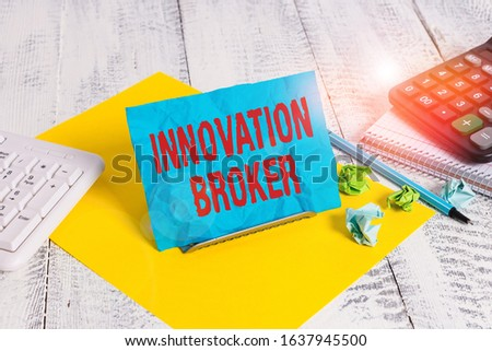 Text sign showing Innovation Broker. Conceptual photo help to mobilise innovations and identify opportunities Notepaper stand on buffer wire in between computer keyboard and math sheets.
