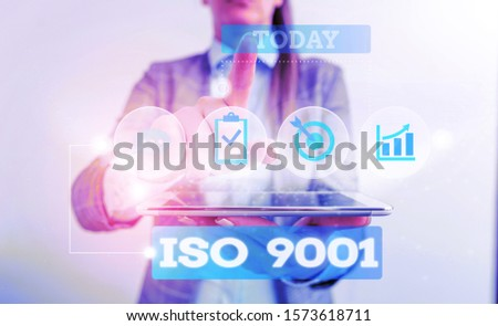 Text sign showing Iso 9001. Conceptual photo designed help organizations to ensure meet the needs of customers Female human wear formal work suit presenting presentation use smart device.
