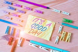 Text sign showing It S A Good Day. Conceptual photo Happy time great vibes perfect to enjoy life beautiful Colored clothespin papers empty reminder wooden floor background office.