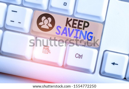 Text sign showing Keep Saving. Conceptual photo keeping money in an account in a bank or financial organization White pc keyboard with empty note paper above white background key copy space.
