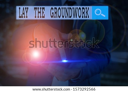 Text sign showing Lay The Groundwork. Conceptual photo Preparing the Basics or Foundation for something.