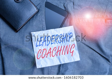 Text sign showing Leadership Coaching. Conceptual photo individualized process that builds a leader s is capability Smartphone device inside trousers front pocket with wallet and note paper.
