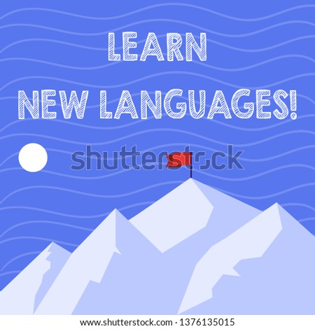 Text sign showing Learn New Languages. Conceptual photo developing ability to communicate in foreign lang Mountains with Shadow Indicating Time of Day and Flag Banner on One Peak.