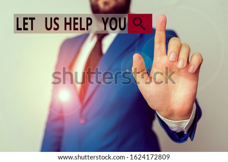 Text sign showing Let Us Help You. Conceptual photo Offering a service to someone to help him in his necessity Businessman with pointing finger in front of him. Foto stock ©