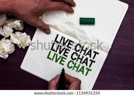 Text sign showing Live Chat Live Chat Live Chat. Conceptual photo talking with people friends relatives online Man holding marker notebook page crumpled papers several tries mistakes. #1134931334