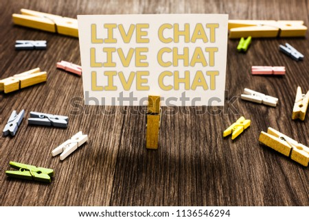 Text sign showing Live Chat Live Chat Live Chat. Conceptual photo talking with people friends relatives online Clothespin holding white paper note several clothespins wooden floor. #1136546294