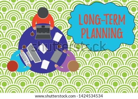Text sign showing Long Term Planning. Conceptual photo Establish Expected Goals five or more years ahead Working round table male employees electronic devices documents coffee cup.