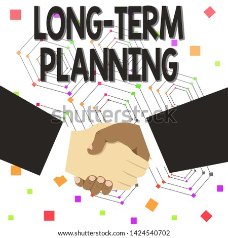 Text sign showing Long Term Planning. Conceptual photo Establish Expected Goals five or more years ahead Hand Shake Multiracial Male Business Partners Colleagues Formal Black Suits.