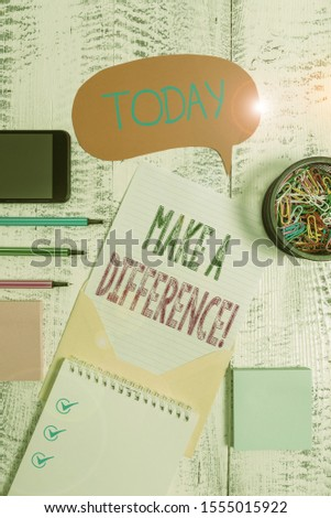 Text sign showing Make A Difference. Conceptual photo have significant effect or non on demonstrating or situation Envelop speech bubble smartphone sheet pens spiral notepads clips wooden.