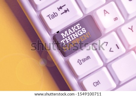 Text sign showing Make Things Happen. Conceptual photo you will have to make hard efforts in order to achieve it White pc keyboard with empty note paper above white background key copy space.