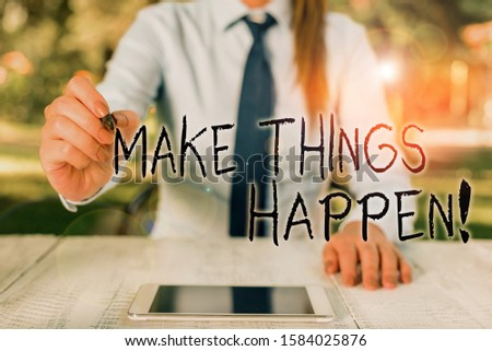Text sign showing Make Things Happen. Conceptual photo you will have to make hard efforts in order to achieve it Female business person sitting by table and holding mobile phone.