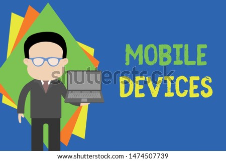 Text sign showing Mobile Devices. Conceptual photo A portable computing device like smartphone tablet computer Standing man in suit wearing eyeglasses holding open laptop photo Art.
