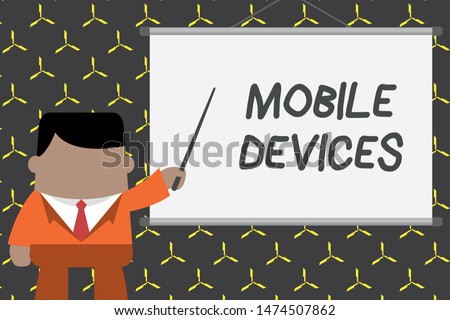 Text sign showing Mobile Devices. Conceptual photo A portable computing device like smartphone tablet computer Businessman standing in front projector screen pointing project idea.