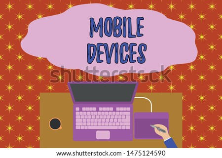 Text sign showing Mobile Devices. Conceptual photo A portable computing device like smartphone tablet computer Upper view laptop wooden desk worker drawing tablet coffee cup office.
