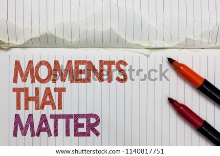 Text sign showing Moments That Matter. Conceptual photo Meaningful positive happy memorable important times White torn page written some letters beside laid two red marker. #1140817751