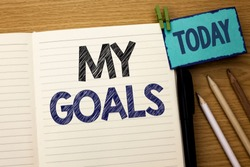 Text sign showing My Goals. Conceptual photo Goal Aim Strategy Determination Career Plan Objective Target Vision written on Notebook Book on the wooden background Today Pencil next to it.