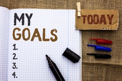 Text sign showing My Goals. Conceptual photo Goal Aim Strategy Determination Career Plan Objective Target Vision written on Notebook Book With Marker on the jute background Today.