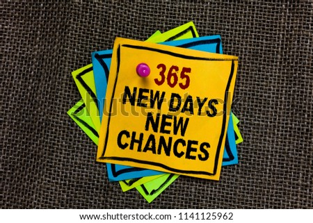 Text sign showing 365 New Days New Chances. Conceptual photo Starting another year Calendar Opportunities Black bordered different color sticky note stick together with pin on jute sack.