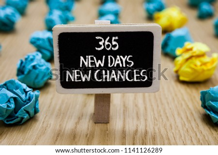 Text sign showing 365 New Days New Chances. Conceptual photo Starting another year Calendar Opportunities Paperclip hold written chalkboard behind paper lumps on woody deck.