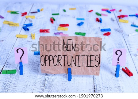 Text sign showing New Opportunities. Conceptual photo exchange views condition favorable for attainment goal Scribbled and crumbling sheet with paper clips placed on the wooden table.