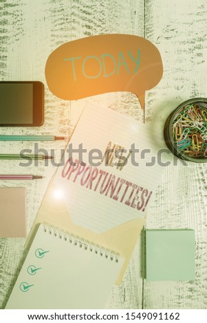 Text sign showing New Opportunities. Conceptual photo exchange views condition favorable for attainment goal Envelop speech bubble smartphone sheet pens spiral notepads clips wooden.