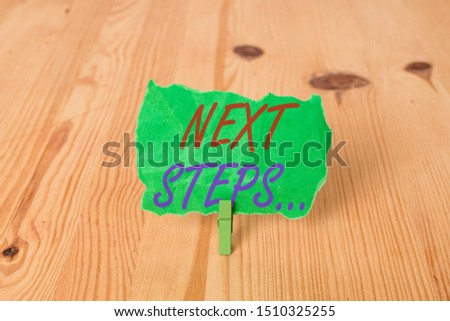 Text sign showing Next Steps . Conceptual photo numper of process going to be made after current one planning Empty reminder wooden floor background green clothespin groove slot office. #1510325255