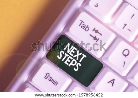 Text sign showing Next Steps. Conceptual photo numper of process going to be made after current one planning White pc keyboard with empty note paper above white background key copy space. #1578956452