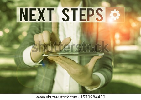 Text sign showing Next Steps. Conceptual photo numper of process going to be made after current one planning Outdoor scene with business woman holds lap top with touch screen. #1579984450